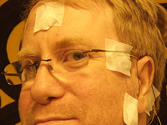 Man with plaster patches on the head