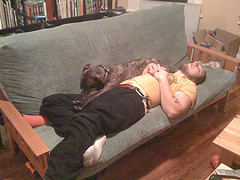 Man and dog sleeping on the sofa