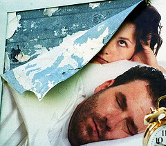 Man snoring, wife awake