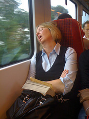 Lady sleeping and snoring in a train
