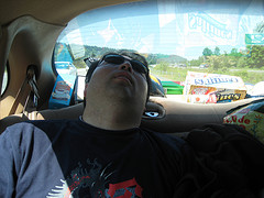 Man sleeping on a car's back seat